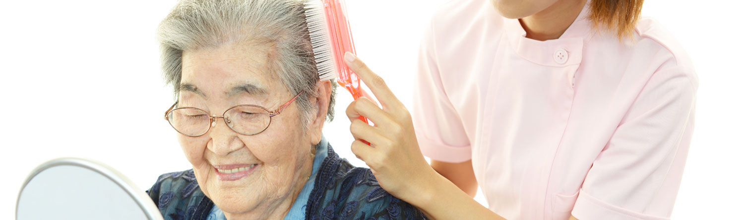 Care Assistant from AevaCare Home Care Watford as a Home Help Watford carer brushing hair of service user and providing personal care