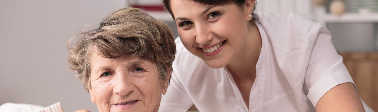 Carer from AevaCare Home Care with service user providing companionship, home help, homecare., home support, care assistant smiling together with lady